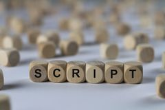 Script - cube with letters, sign with wooden cubes Stock Photos