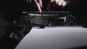 Script writer on a typewriter writes a screenplay for the film. Script writer on a typewriter writes a script for a new film that will be released soon stock footage