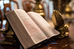 Scripture with gold praying hands Stock Image