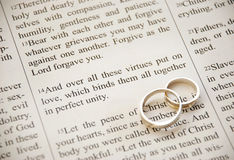 Scripture and rings stock image