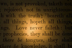 Scripture verse. Extreme close up of a Bible verse about love Stock Photography