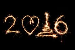2016 scritto con i fuochi d'artificio come fondo Fotografia Stock