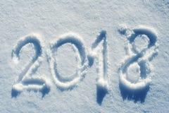 2018 scritto nella traccia 01 della neve Immagini Stock