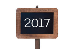 2017 scritto su un segno di legno d'annata isolato su fondo bianco Immagini Stock
