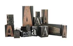 Scritto tipografico A in legno ed in meta Fotografia Stock Libera da Diritti