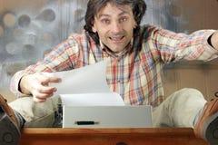 Scrittore felice Immagine Stock