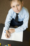 Scrittura adorabile del bambino. Fotografie Stock