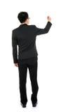 Scrittura completa dell'uomo di affari del corpo di vista posteriore Immagine Stock