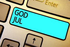Scrittura concettuale della mano che mostra Dio luglio Foto di affari che montra il Buon Natale che accoglie la gente per la chia Fotografie Stock Libere da Diritti