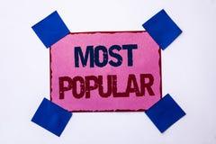 Scrittura concettuale della mano che mostra più popolare Prodotto del bestseller di valutazione della cima del testo della foto d fotografia stock