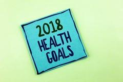 Scrittura concettuale della mano che mostra salute 2018 Golas Foto di affari che montra gli scopi sani w di risoluzione dell'alim Fotografia Stock