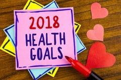 Scrittura concettuale della mano che mostra salute 2018 Golas Scopi sani di risoluzione dell'alimento di allenamento di piano del Immagine Stock
