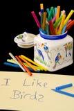Scrittura dei bambini con i pastelli Fotografia Stock