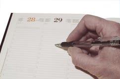 Scrittura del diario del calendario Immagini Stock