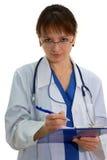 Scrittura del medico a bordo Fotografia Stock