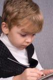 Scrittura del ragazzo Fotografia Stock Libera da Diritti