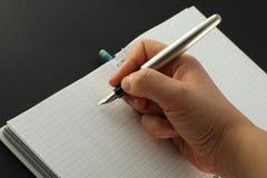 Scrittura del taccuino. fotografia stock libera da diritti