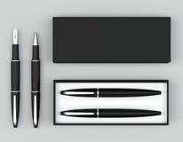 Scrittura dell'insieme Penna a penna ed inchiostro della palla con una scatola su un backgro luminoso Fotografie Stock