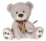 Scrittura dell'orso sul cuscinetto Fotografia Stock Libera da Diritti