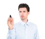 Scrittura dell'uomo d'affari con un indicatore Immagine Stock