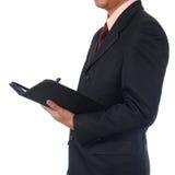 Scrittura dell'uomo d'affari per l'ordine immagine stock