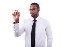 Scrittura dell'uomo di affari dell'afroamericano fotografia stock libera da diritti