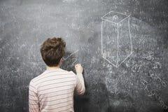 Scrittura dell'uomo sulla lavagna Immagine Stock Libera da Diritti