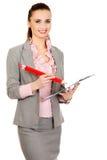 Scrittura della donna di affari con la grande matita Immagine Stock