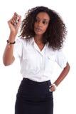 Scrittura della donna di affari dell'afroamericano Fotografia Stock