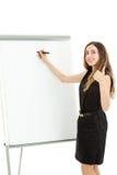 Scrittura della donna di affari su un bordo e dare sui pollici su Fotografia Stock