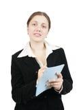 Scrittura della donna di affari su un taccuino Fotografia Stock Libera da Diritti
