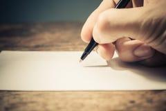 Scrittura della mano fotografie stock