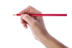 Scrittura della mano con la matita rossa Immagine Stock