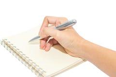 Scrittura della mano con la penna isolata su bianco Immagini Stock