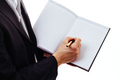 Scrittura della mano dell'uomo d'affari con la penna stilografica Fotografie Stock
