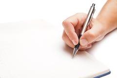 Scrittura della mano dell'uomo in libro aperto su bianco Fotografia Stock Libera da Diritti
