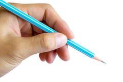 Scrittura della mano sinistra con la matita Fotografie Stock Libere da Diritti