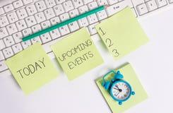 Scrittura della nota che mostra gli eventi imminenti Foto di affari che montra le occasioni pubbliche o sociali previste d'avvici fotografia stock