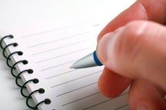 Scrittura della penna Immagini Stock