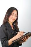 Scrittura della ragazza nell'organizzatore personale Fotografia Stock Libera da Diritti