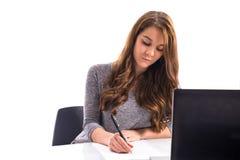 Scrittura della ragazza sul documento Immagine Stock Libera da Diritti