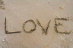 Scrittura della sabbia Immagini Stock