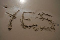 Scrittura della sabbia - sì Immagine Stock Libera da Diritti