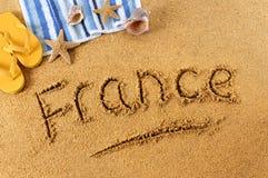 Scrittura della spiaggia della Francia Immagini Stock
