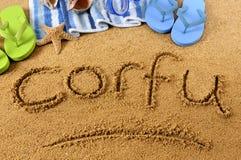 Scrittura della spiaggia di Corfù Immagini Stock Libere da Diritti