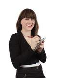 Scrittura femminile del gestore su un taccuino Fotografia Stock