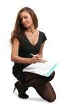 Scrittura femminile del gestore su un taccuino Immagini Stock Libere da Diritti