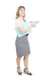 Scrittura femminile del gestore su un taccuino sopra bianco Fotografia Stock