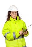 Scrittura femminile dell'operaio di costruzione fotografia stock