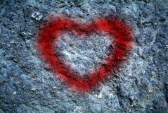 Scrittura a forma di del cuore sulla parete Fotografie Stock Libere da Diritti